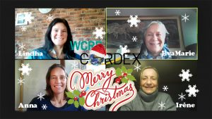 A snapshot from a video meeting with four women. The photo is decorated with Merry Christmas and falling snow